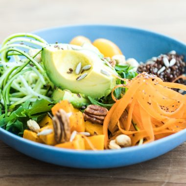 A vegan salad in a blue bowl